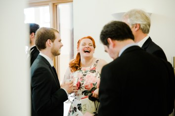 guest laughing at wedding reception natural relaxed wedding Leamington Spa Relaxed Church reportage photography