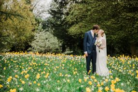 bride and groom among spring flowers jephson gardens leamington spa natural relaxed wedding Leamington Spa Relaxed Church reportage photography