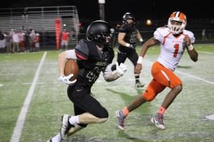 Caleb Gerken runs for a touchdown Friday, October 7th against Southview. Photo credit: Chris Gulguin