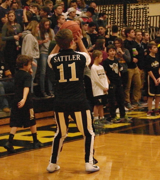 Senior Griff Sattler takes a jump shot during warmups as the team prepares for the big game.