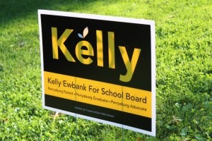Sign reads Kelly. Kelly Ewbank For School Board. Perrysburg parent. Perrysburg graduate. Perrysburg Advocate. Paid for by Friends to Elect Kelly Ewbank