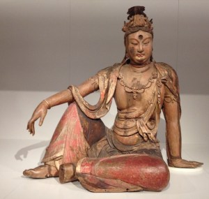 Buddhist deily Guanyin, meditating on a rock