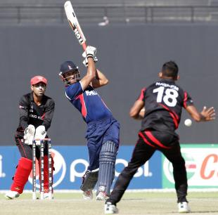 Paras Khadka smashes one down the ground, Hong Kong v Nepal, ICC World Twenty20 Qualifier, quarter-final, Abu Dhabi, November 27, 2013