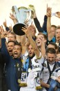 Landon Donovan (10) of the Los Angeles Galaxy holds up the Philip F. Anschutz Trophy after winning the 2012 MLS Cup, as seen on ESPN. (Scott Clarke / ESPN Images)