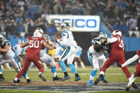 Arizona vs. Carolina (Jan. 3, 2015): An audience of 21,678,000 watches the first NFL Playoff game in ESPN's 35-year history as Cam Newton and the Carolina Panthers defeat the Arizona Cardinals, 27-16, in the Wild Card round. (Scott Clarke/ESPN Images)