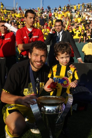"""Moreno celebrated the 2008 MLS Cup victory with his oldest son, Alejandro (then 4 years old), in this photo. Moreno says of the Crew fans: """"We have a connection that I can't really explain. I know that walking into that stadium always fills me up with a tremendous sense of pride and accomplishment."""" (Photo courtesy Columbus Crew SC)"""
