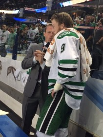 Kessenich conducts an interview during ESPN's coverage of the Frozen Four. (Photo courtesy of Quint Kessenich)