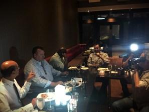 ESPN Radio host Paul Finebaum (left) chats with Bret Bielema. (Photo courtesy of Mike McKinnis/JM Associates)