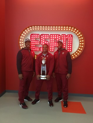 (L-R) Temple football stars Avery Ellis, Avery Williams, Haason Reddick brought the American Athletic Conference trophy to ESPN. (Bethany Karantonis/ESPN)
