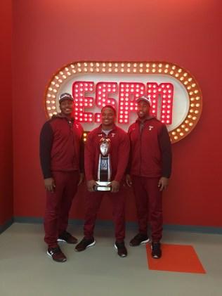 (L-R) Temple football stars Avery Ellis, Avery Williams, Haason Reddick brought the American Athletic Conference trophy to ESPN. (Bethany Karantonis/ESPN)