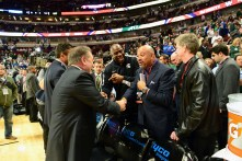 In Chicago, Nov. 12, 2013 at the United Center: Tom Izzo (L), Michigan State coach, greets ESPN's Michael Wilbon as Magic Johnson looks on during the State Farm Champions Classic. (Phil Ellsworth/ESPN Images)