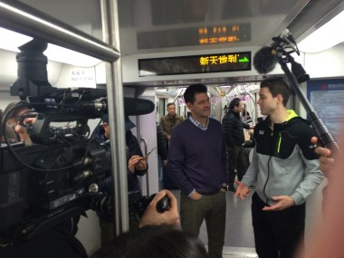 Tom Farrey and Fredette talk while on the subway. (Simon Baumgart/ESPN)