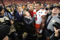 Holly Rowe interviews QB Deshaun Watson after Clemson's 2017 CFP National Championship Game victory. (Allen Kee/ESPN Images)