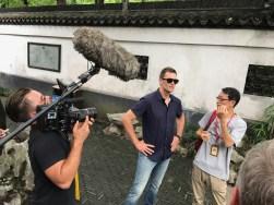 Tom Brady tours a Yu Garden. (Photo courtesy of Kevin Negandhi/ESPN)