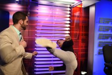 Phil Murphy (L) duels with Conor McGregor on the set of MMA Live Extra. (Joe Faraoni/ESPN Images)