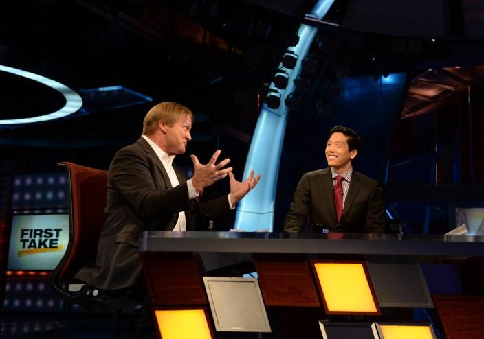 Cary Chow (R) interviews MNF analyst Jon Gruden. (Joe Faraoni/ESPN Images)