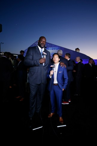 Cary Chow (R) interviews Shaquille O'Neal at the 2016 ESPYS. (Eddie Perlas/ESPN Images)