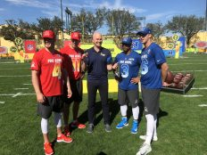 Hasselbeck (center) interviews QBs (L-R) Derek Carr, Alex Smith, Russell Wilson and Jared Goff. (Andy Hall/ESPN)