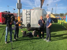 Orlando's WFTV sports reporter Christian Bruey interviews Hasselbeck. (Andy Hall/ESPN)