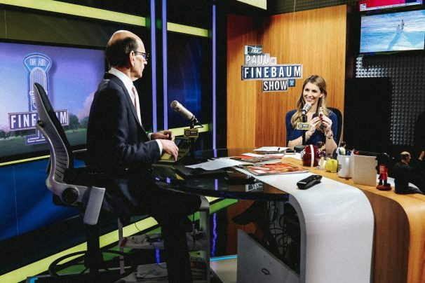 Laura Rutledge (R) got some advice, and a miniature bobblehead, from colleague Paul Finebaum before heading to Bristol to anchor SportsCenter for the first time. (Lacey Gandee/ESPN)
