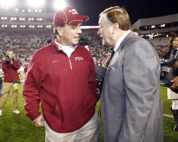 2010: Mike Patrick (R) speaks with then-Florida State coach Jimbo Fisher. (Don Juan Moore/ESPN Images)