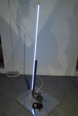 Alpha Tensione, 2012 Ferro, neon, acciaio, limatira di ferro e trasformatore, cm.46x59x155