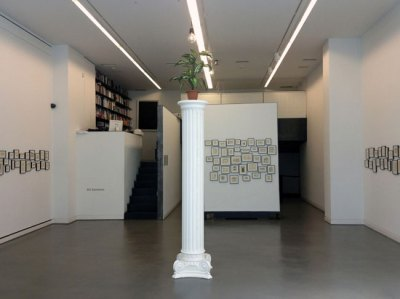 Architecture of Good and Evil, 2012, Mixed media installation Floor: Inverted replica of an Ionic column, fake exotic plant, designer's lamp, 52 cm x 52 cm x 250 cm (column's dimensions) Walls: 172 works on paper (blue ink on printed paper), various dimensions. Courtesy: Kalfayan Galleries, Athens - Thessaloniki