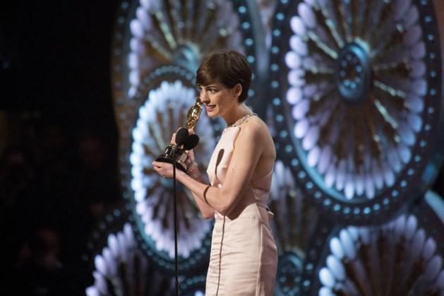 """Anne Hathaway accepts the Oscar® for performance by an actress in a supporting role for her role in """"Les Misérables"""" during the live ABC Telecast of The Oscars® from the Dolby® Theatre in Hollywood, CA, Sunday, February 24, 2013. credit: Greg Harbaugh / ©A.M.P.A.S."""