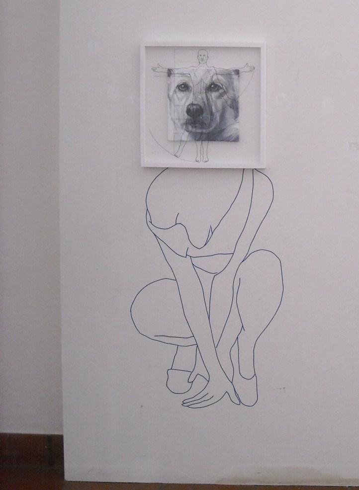Constantin Migliorini, super bastardo 2, olio acrilico su tela e pennarello su vetro,cm 52x52 + nastro adesivo nero su muro