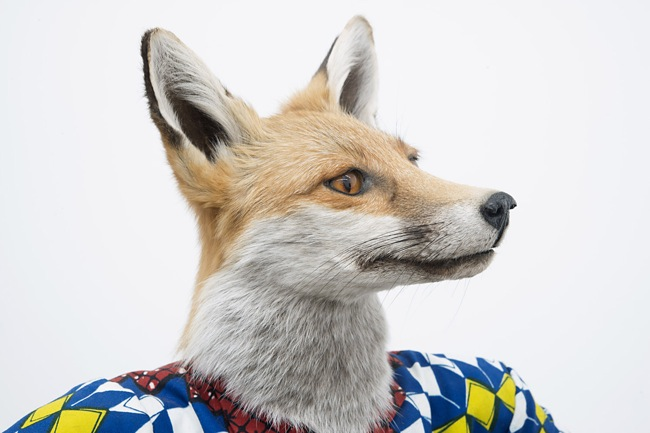 Yinka Shonibare MBE Revolution Kid (fox girl), 2012, detail, Mannequin, Dutch wax printed cotton, fibreglass, leather, taxidermy fox head, steel base plate, BlackBerry and 24 carat gold gilded gun, 111.8x91.4x76.2cm, Courtesy of the artist and James Cohan Gallery, New York and Shanghai