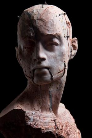 Christian Zucconi, Testa III, 30x20,5x41Travertino persiano, ferro e cera 2014