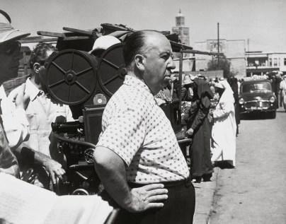 """Alfred Hitchcock sul set de """"L'uomo che sapeva troppo"""" (1956) © 2014 Universal Studios. Tutti i diritti riservati MONDADORI PORTFOLIO/ALBUM"""