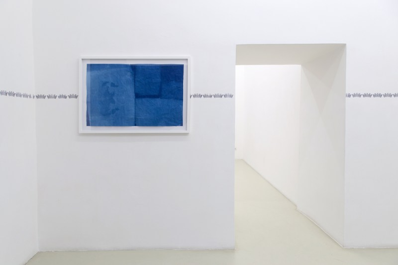 La Muralla Azul, 2014, installation rubber stamp on wall, 5 exposed Sunprint papers, mediterranean sun and mediterranean water, var. dim.