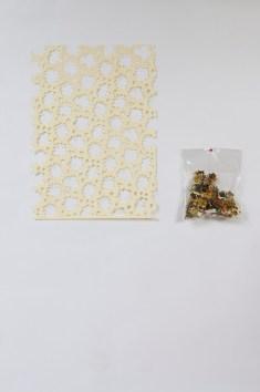 Gianluca Quaglia, Il luogo dei fiori e dei frutti, 2015, intagli su carta, busta di plastica, intaglio 70x50 cm, busta 40x30 cm Foto Marcella Savino
