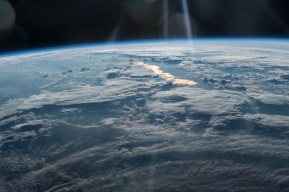NASA, Beams of Light on a Golden Lake, image taken by the Expedition 47 crew on May 31, 2016, from the International Space Station looks from northwestern China on the bottom into eastern Kazakhstan Courtesy of NASA