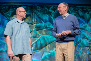 Esri program manager Jim McKinney (left) and Esri president Jack Dangermond welcome developers back to Palm Springs.
