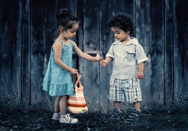 boy and girl holding hand