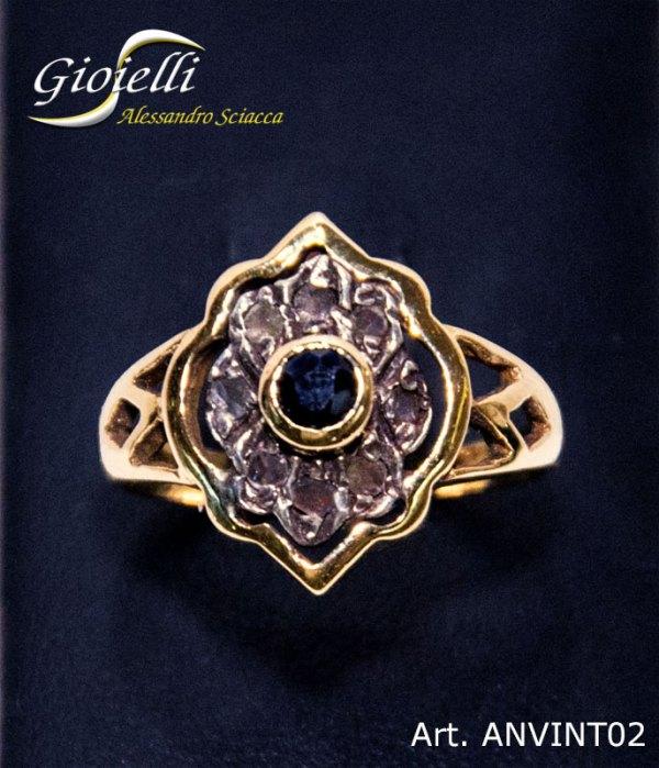 Anello vintage in oro giallo con zaffiro centrale taglio brillante e contorno di 8 diamanti taglio rosetta
