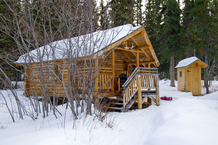 One of the four cosy cabins with outside toilet