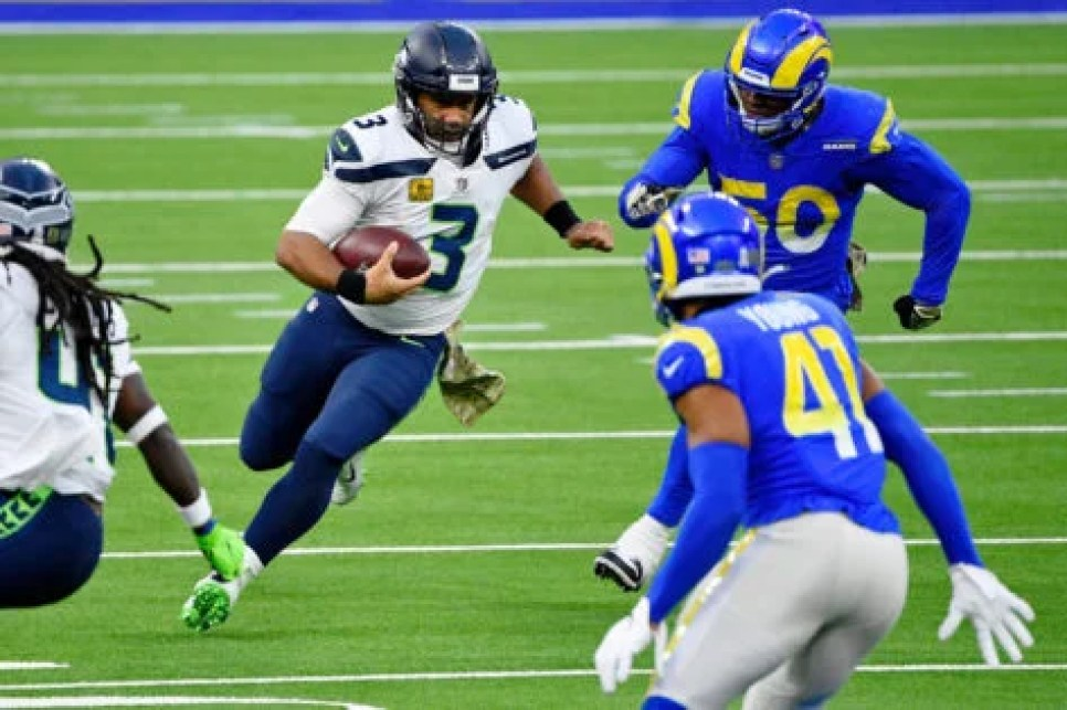 Seattle Seahawks quarterback Russell Wilson attempts to run with the ball against Los Angeles Rams.