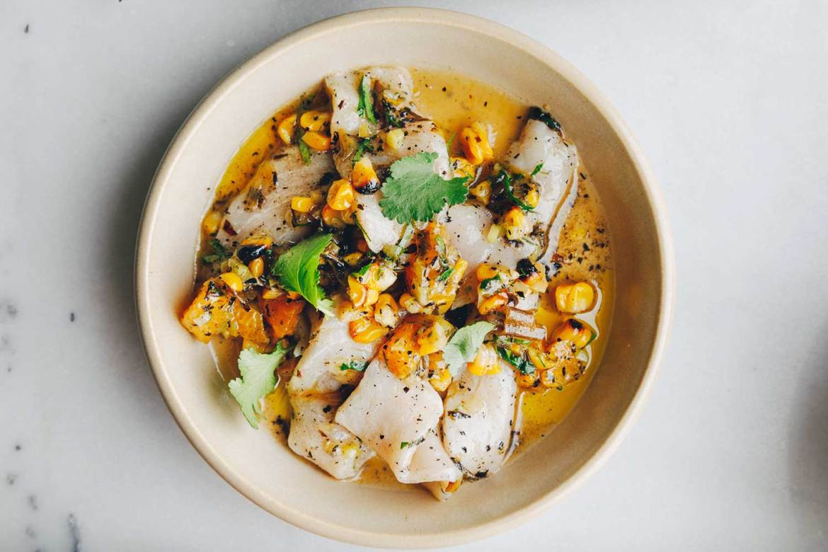 White fish ceviche with charred corn and coriander leaf