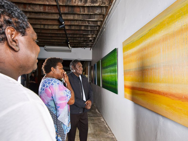 Artists admire their work at Waanta Mukana – Our Many Yarns, Our Many Stories.