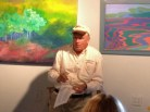Bill Poppino reading poetry at Adirondack Art Association in Essex, NY