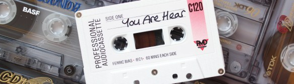 You Are Hear banner showing cassette tapes