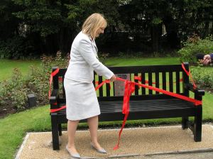 Picture of Cllr Young cutting ribbon on bench