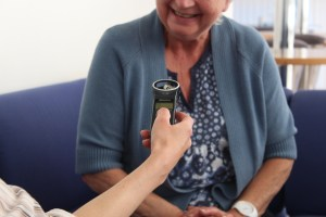 Photograph of subject being interviewed with recorder