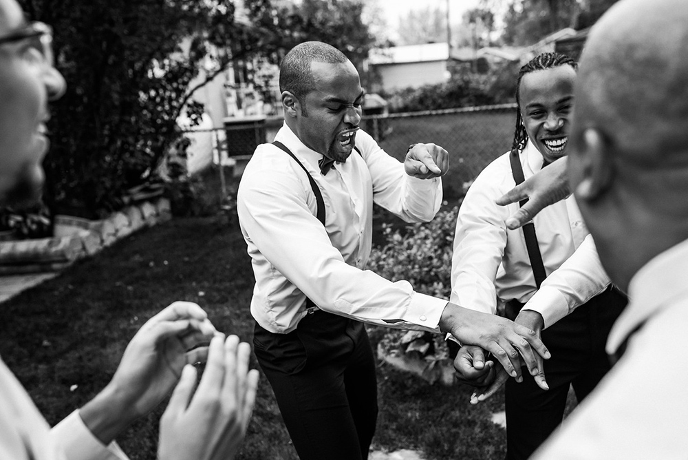 Groomsmen chant together before wedding