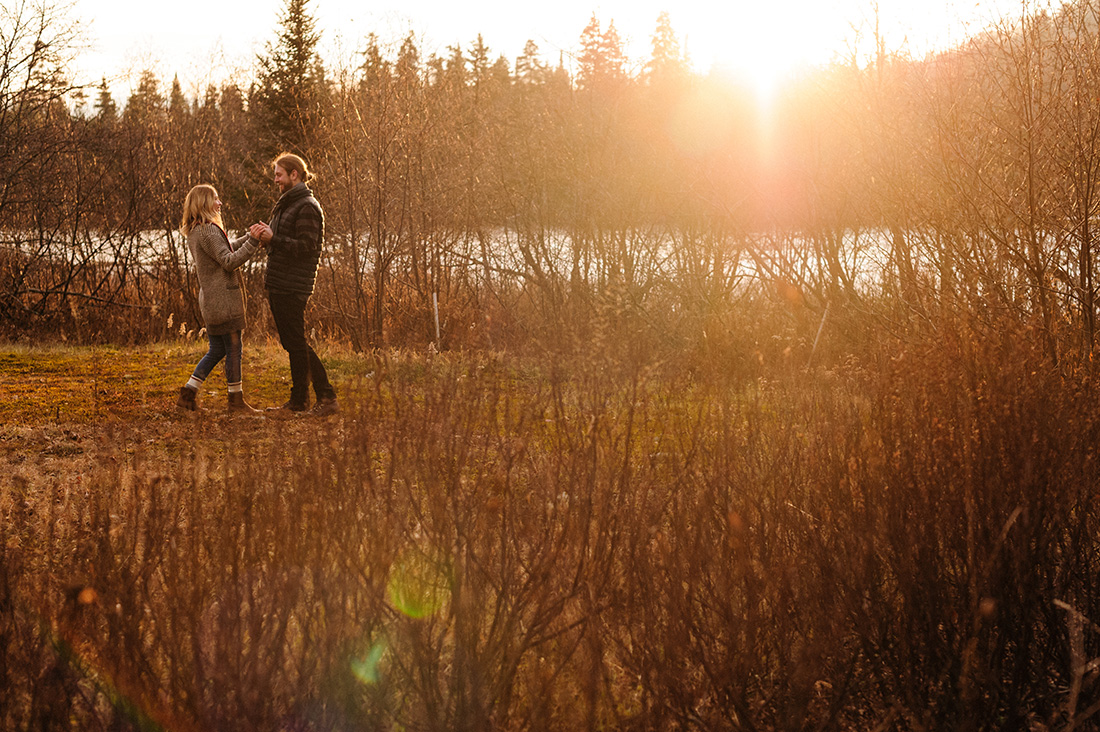 Couple in sunset during Mont Tremblant engagement photoshoot
