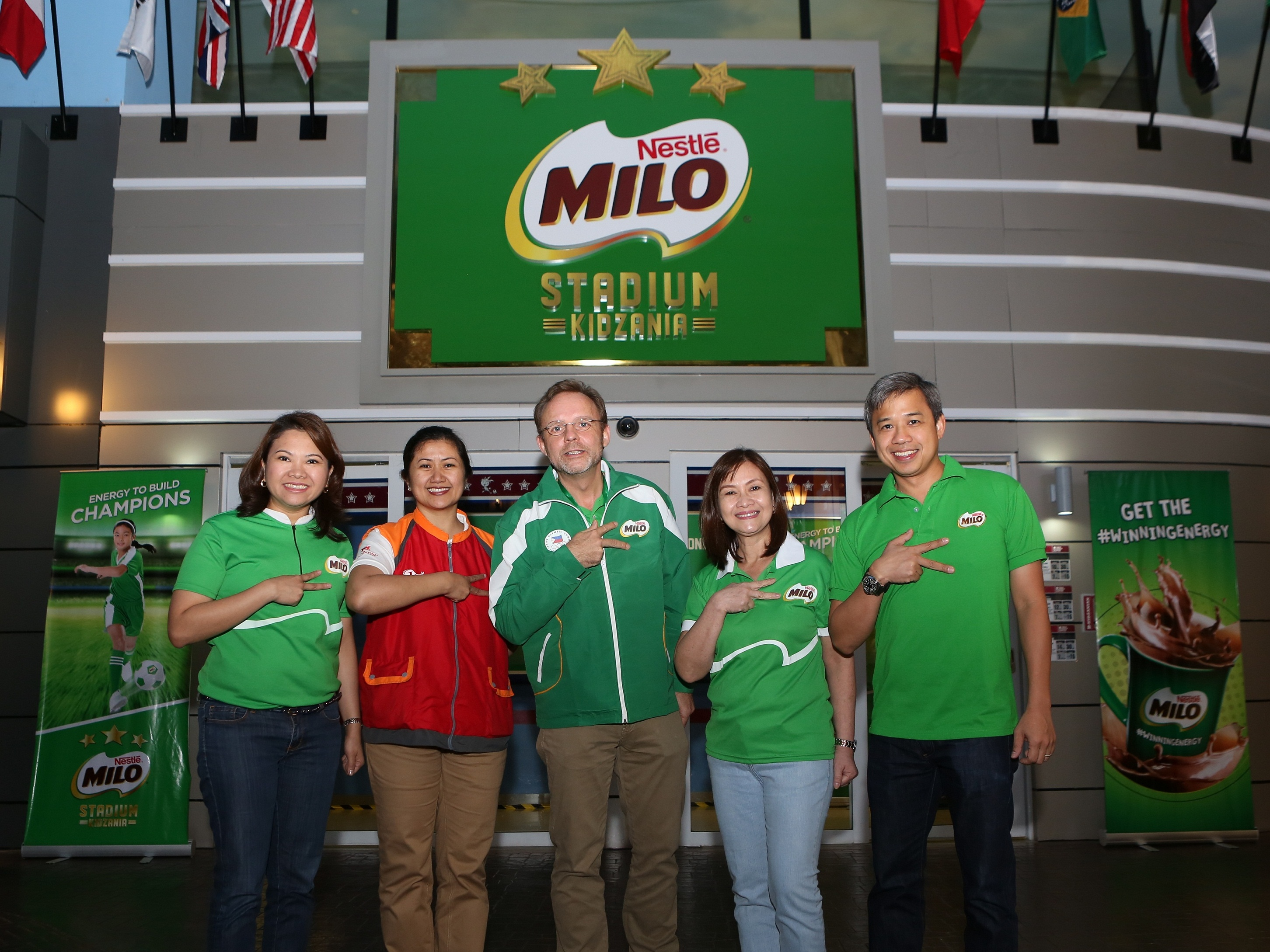 (from L-R): Ellen Isturis (Team Lead, MILO Philippines), CecilleMariño (Minister of Industry, KidZania Manila), Jacques Reber (Chairman and CEO, Nestlé Philippines Inc.), Aurora Alipao (Head of Corporate Communications & Consumer Services, Nestlé Philippines Inc.) and Joey Uy (Business Executive Manager, Liquid Beverages, Nestlé Philippines Inc.) formally open the doors to the MILO Stadium.