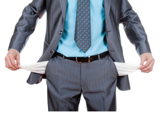 businessman standing and showing his empty pocket